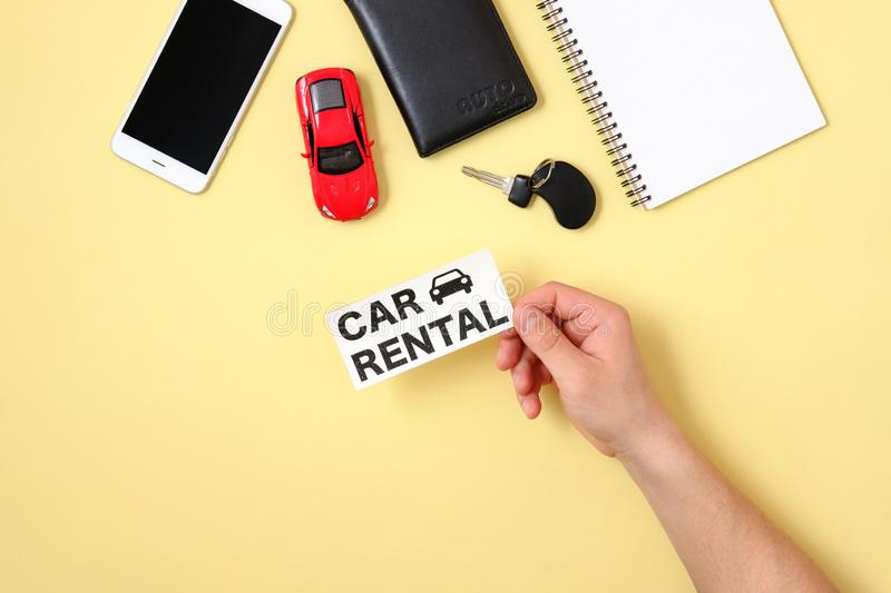Car rental concept. Human hand holding text sign stock images