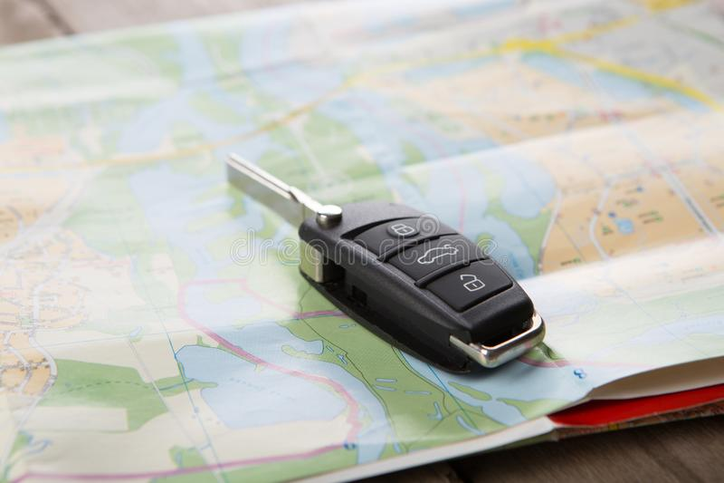 Car rental concept - car key on the map. Car rental concept - car key on the road map, atlas, automobile, destination, drive, highways, journey, tourism, travel stock photo