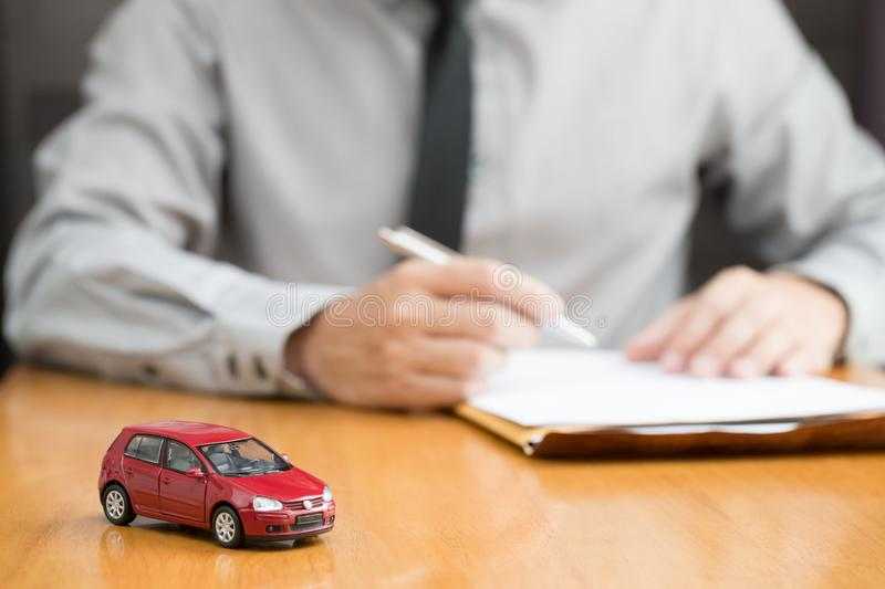 Car rental inspector filling contract, royalty free stock photos