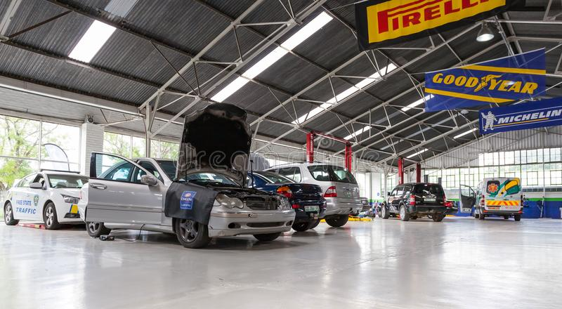 Car repair garage with cars waiting to be fixed. royalty free stock photo