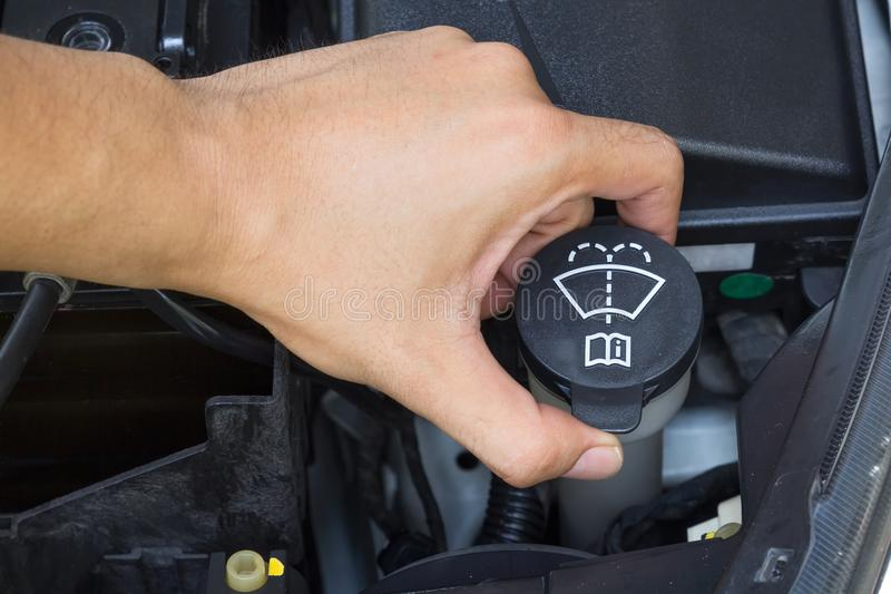Car repair service, Auto mechanic checking water level in a engine stock photo