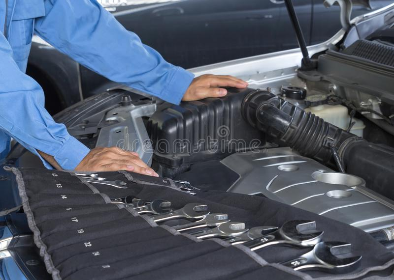 Car repair service, Auto mechanic repairing car engine royalty free stock photography
