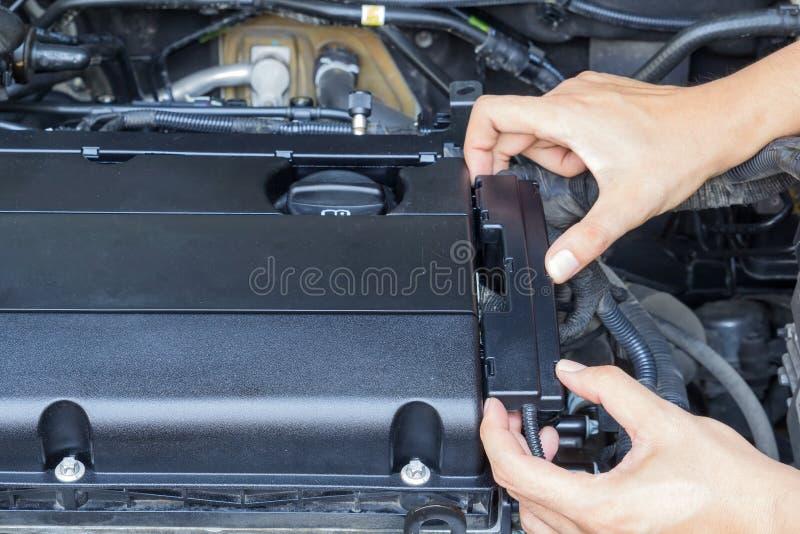 Car repair service, Auto mechanic repairing car engine royalty free stock photos