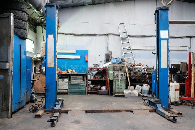 Car repair station. Lift in a car repair station stock photo