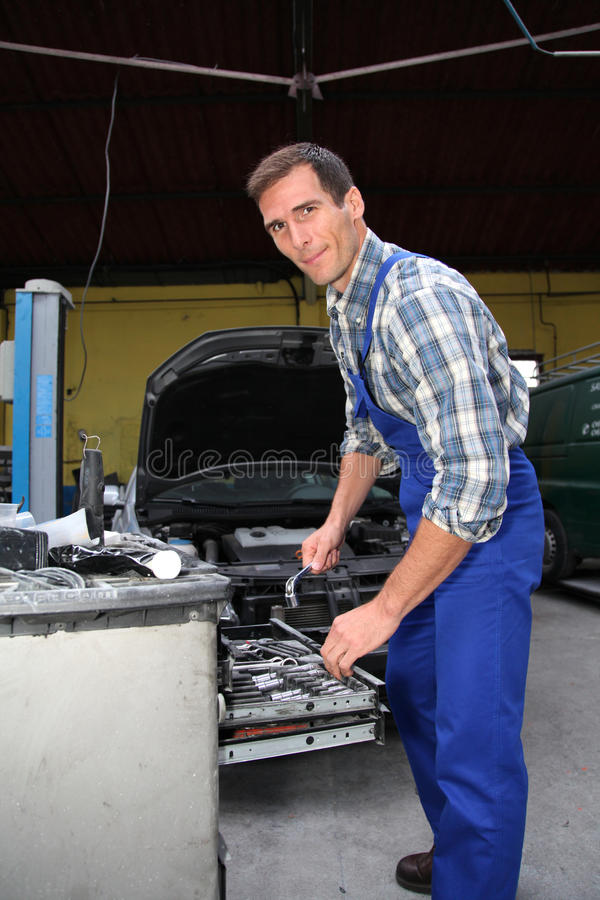 Car repairer at work royalty free stock images