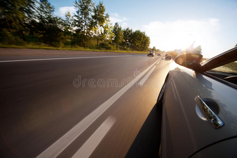 Car ride on road in sunny weather stock photos