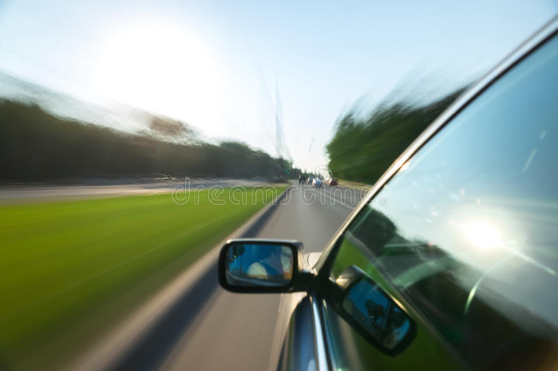 Car ride on road. In sunny weather, motion blur royalty free stock image