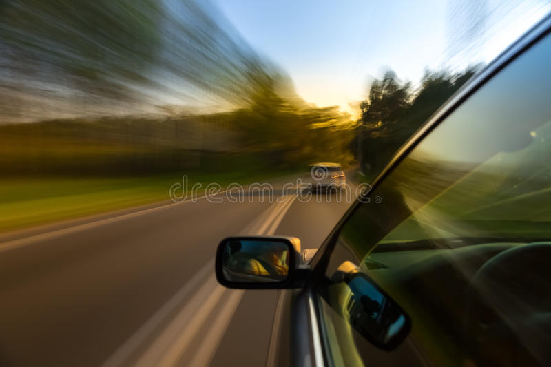 Car ride on road. In sunny weather, motion blur royalty free stock photo