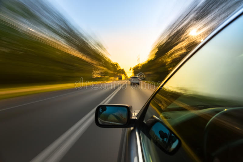 Car ride on road. In sunny weather, motion blur stock photography