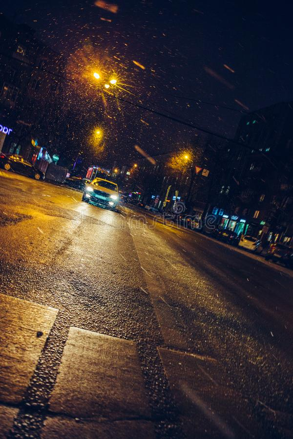 Car rides on city street in night, winter urban road lights and transportation concept royalty free stock image