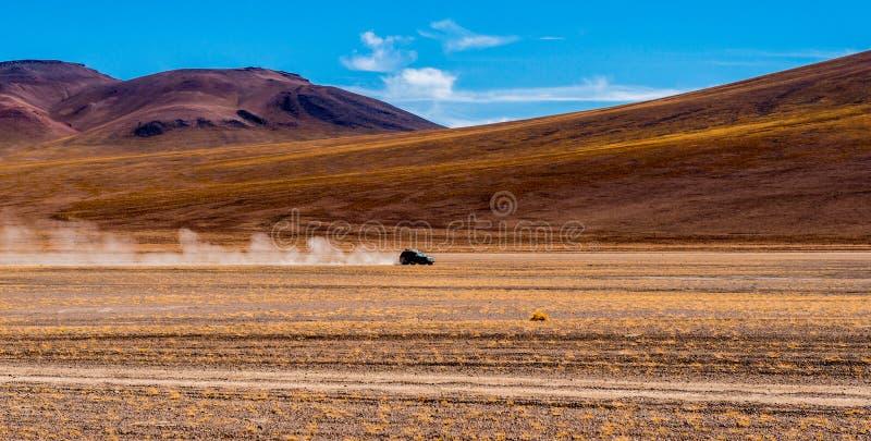 Car riding in Bolivian sunshine landscape stock photo