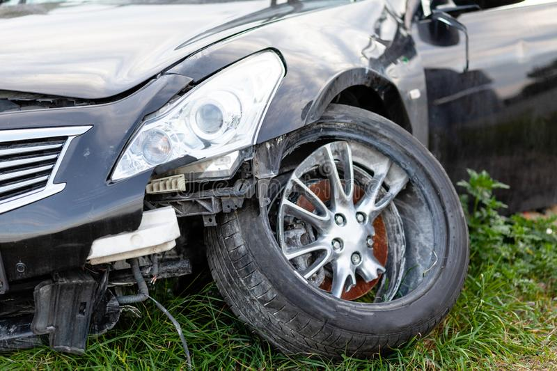 Car in road accident. Close-up of wheel and headlights.  stock photography