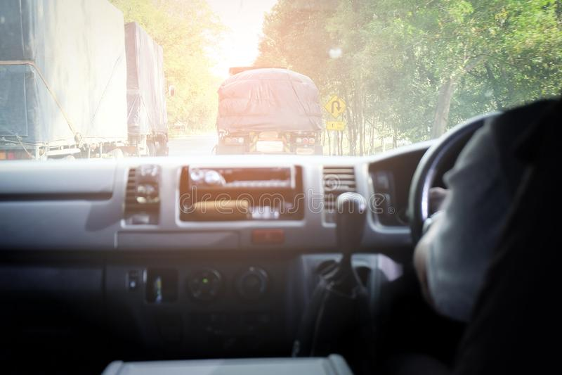 Car is on the road with both front. The car is on the road with both front and side trucks stock image