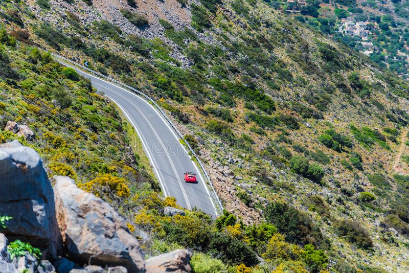 The car on the road in the mountain. Aerial view. royalty free stock photography