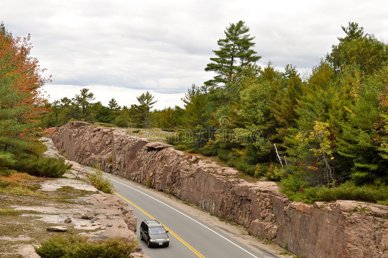 Download Car On A Road Through A Rock Cut Stock Photo - Image: 16327724