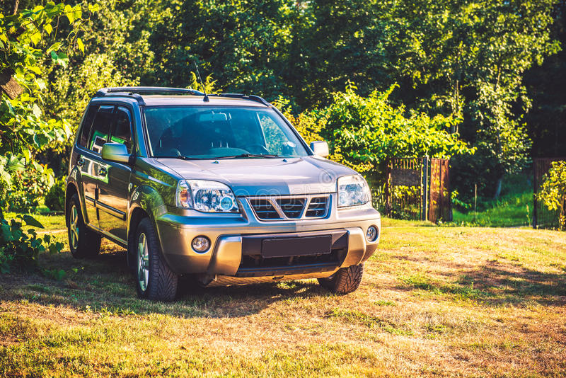 Car road suv. In green countryside field royalty free stock photography