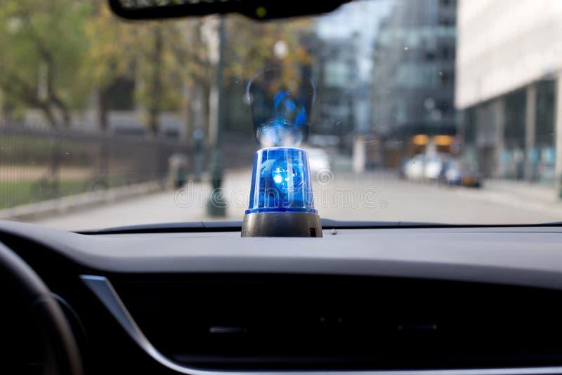 Car with rotating emergency light. Car dash with rotating emergency light stock photos