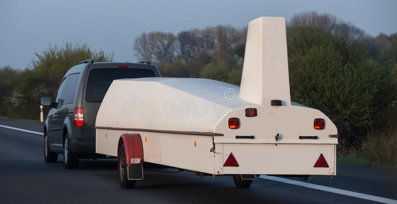 Car with a sailplane trailer royalty free stock image