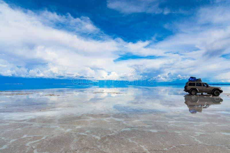 Car on Salar de Uyuni. Amazing Salar de Uyuni, Bolivia stock photo
