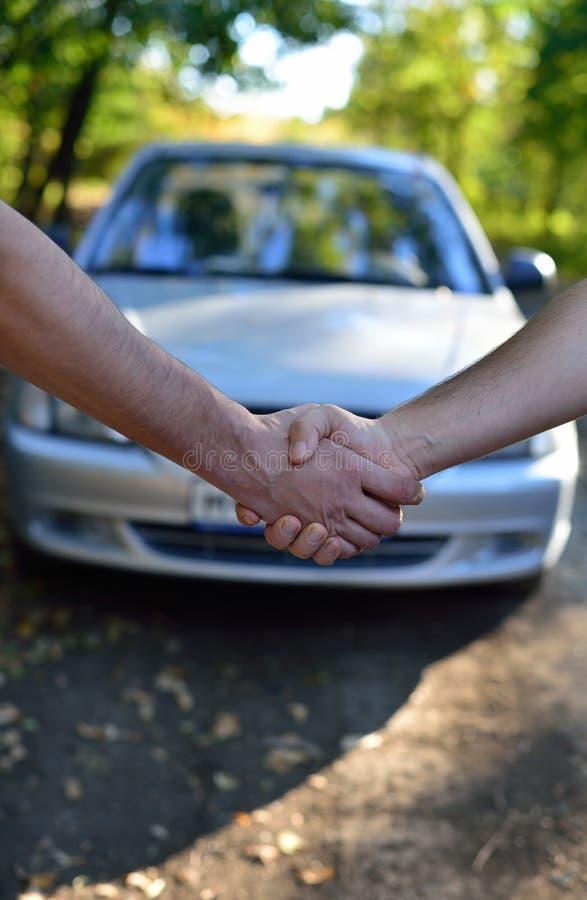 Car sale. Handshake stock photos
