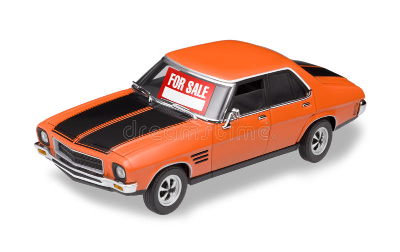 Car For Sale. An older model car with a for sale sign isolated on white royalty free stock photo