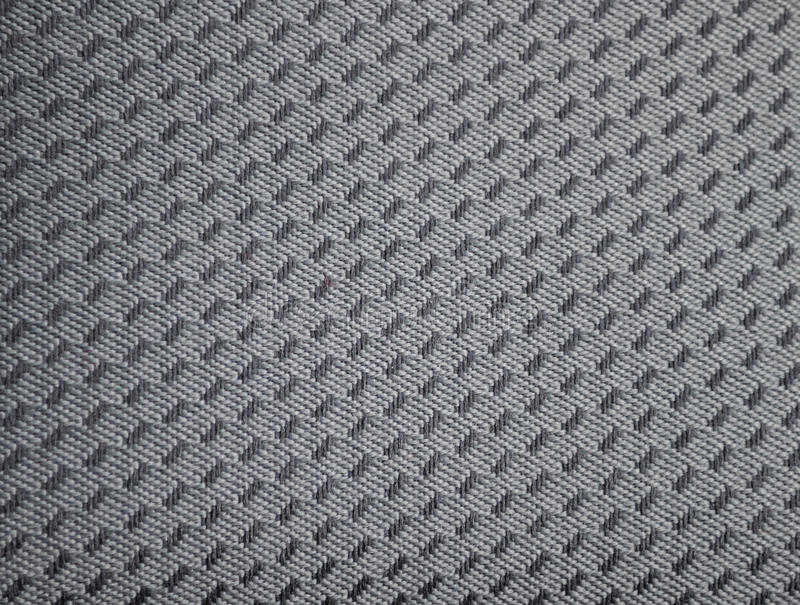Car seat upholstery. This photograph represent detail of Gray Car Upholstery stock photo