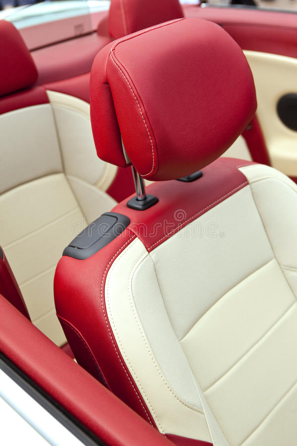 Car seats. Inside a convertible car, leather seats red and white stock photos