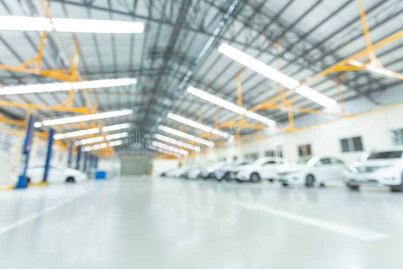 Car service center, interior car-care center. cars in the service put on the epoxy floor, The electric lift for cars.  stock image
