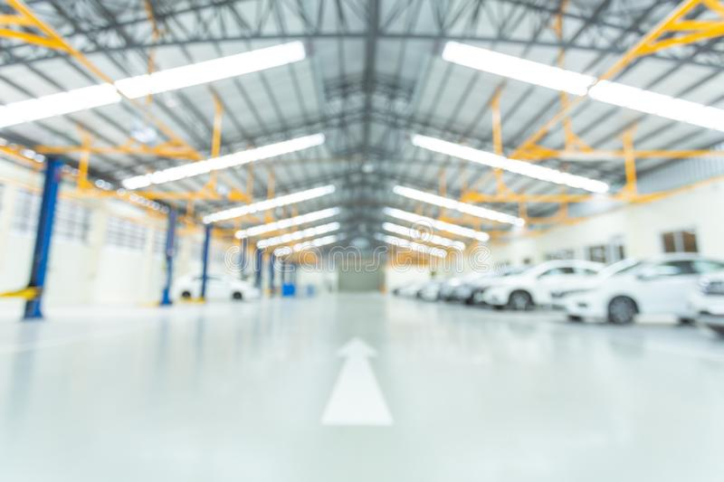 Car service center, interior car-care center. cars in the service put on the epoxy floor, The electric lift for cars royalty free stock photos
