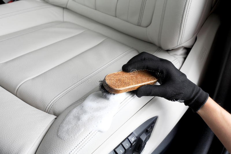 Car service. Washing of interior by a brush royalty free stock photos