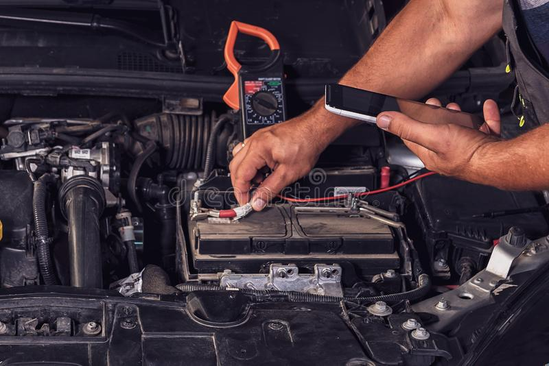 Fixing Car At Auto Repair Shop Stock Photo - Image of ...