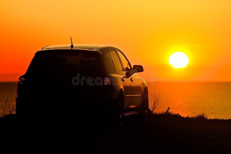 Car and setting sun stock photo