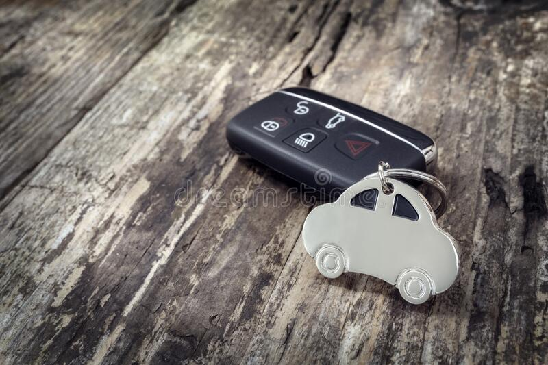 Car shape keyring and keyless entry remote royalty free stock photography