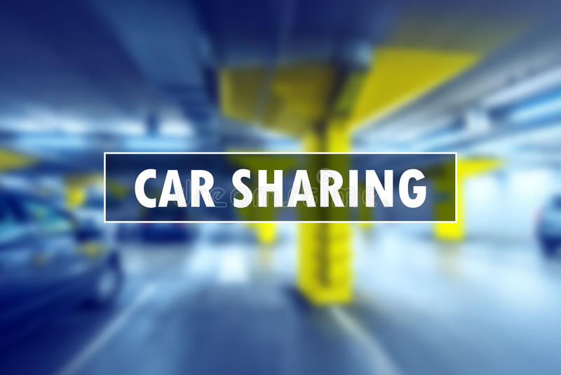 Car sharing or carsharing concept. For model of vehicle rental for short periods of time, blur underground garage parking lot in background stock photography