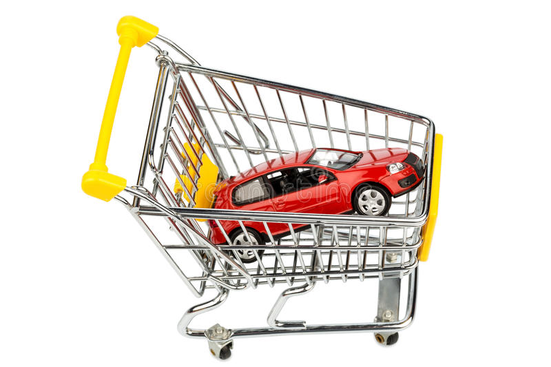 Car in shopping cart. A car in the shopping cart as a symbol for car buying and leasing royalty free stock photo