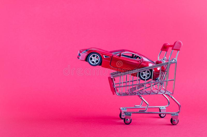 Car shopping, new car in a shopping cart stock photos