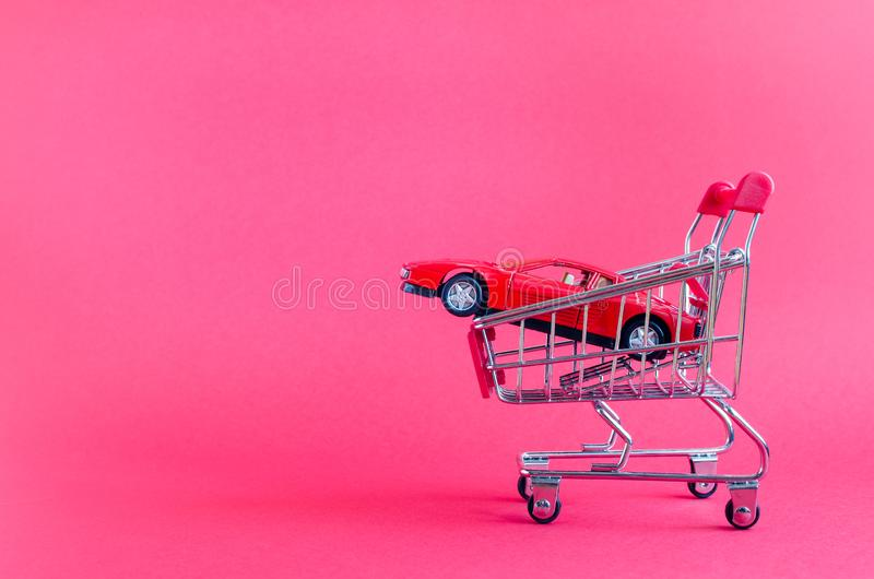 Car shopping, new car in a shopping cart royalty free stock photo