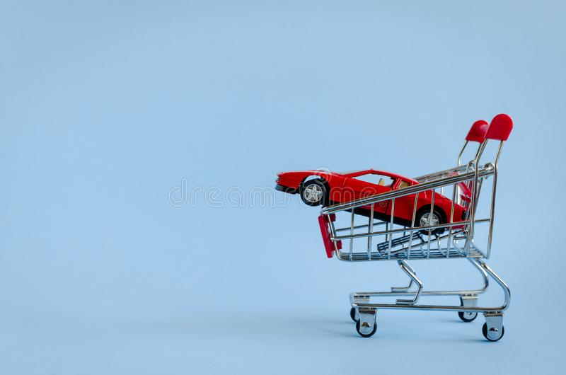 Car shopping, new car in a shopping cart stock images