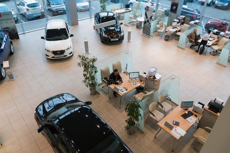 Car in showroom of dealership Nissan in Kazan city. View from the top. Kazan, Russia - October 19, 2017: Car in showroom of dealership Nissan in Kazan city. View royalty free stock image