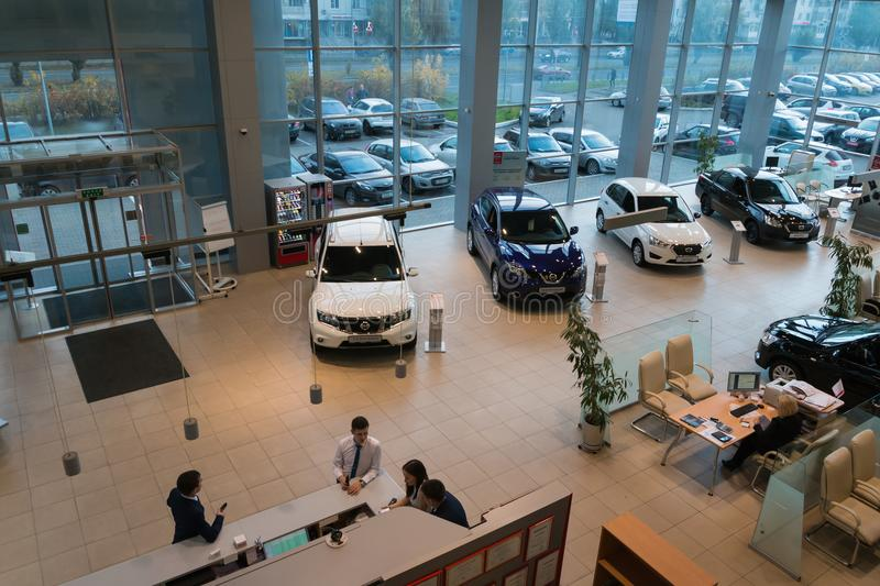 Car in showroom of dealership Nissan in Kazan city. View from the top. Kazan, Russia - October 19, 2017: Car in showroom of dealership Nissan in Kazan city. View stock photography