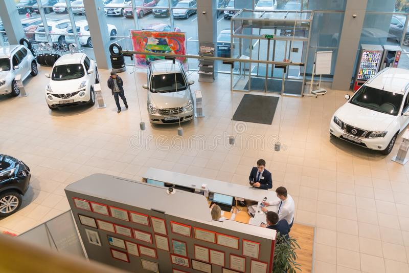 Car in showroom of dealership Nissan in Kazan city. View from the top. Kazan, Russia - October 19, 2017: Car in showroom of dealership Nissan in Kazan city. View stock photo