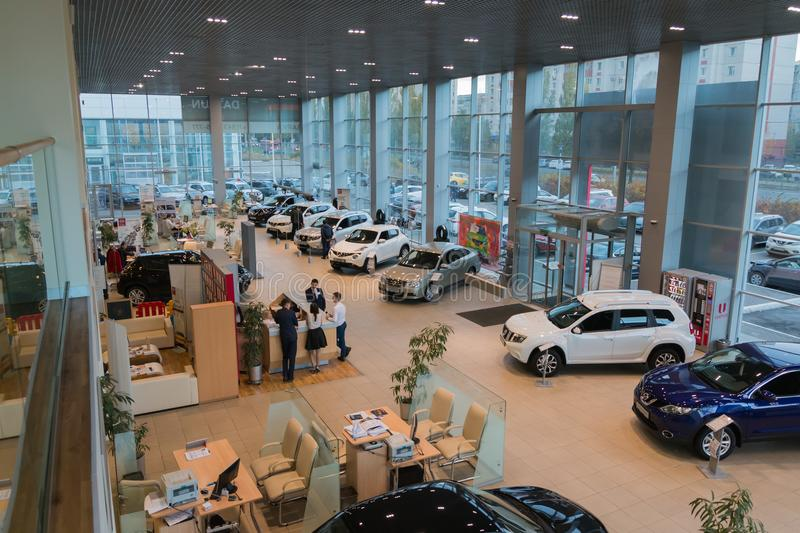 Car in showroom of dealership Nissan in Kazan city. View from the top. Kazan, Russia - October 19, 2017: Car in showroom of dealership Nissan in Kazan city. View stock photos