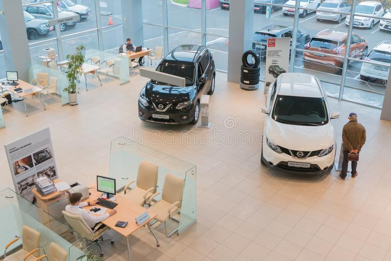 Car in showroom of dealership Nissan in Kazan city. View from the top. Kazan, Russia - October 19, 2017: Car in showroom of dealership Nissan in Kazan city. View stock image