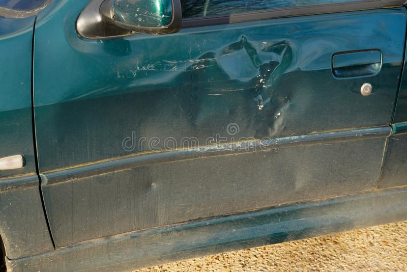 Car side broken is scratch scrap with damage to paint wreck royalty free stock photos