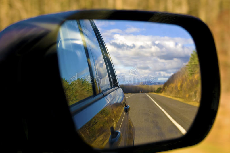 Car Side Mirror. Scenery and reflextions of it on the car captured on the side mirror stock image