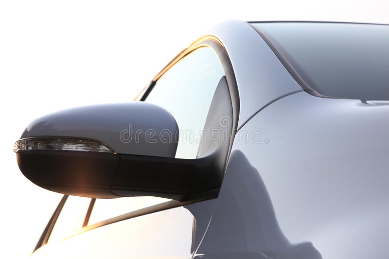 Car side mirror. Low angle view royalty free stock image