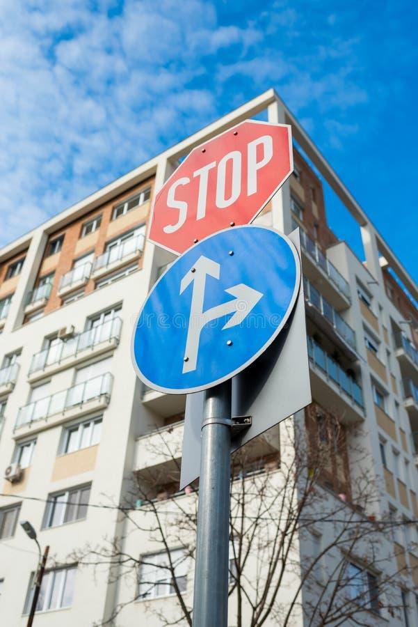 Car sign cj with mandatory stop sign. Car sign with a mandatory stop sign on the building background stock photography
