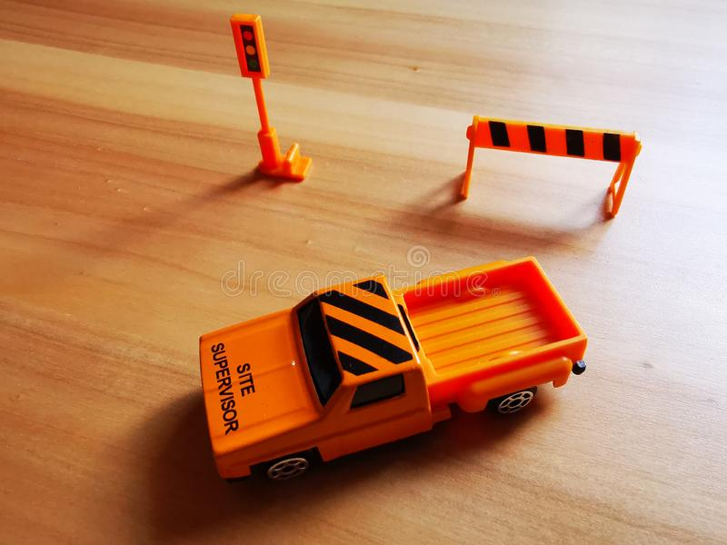 Car site supervisor layout - trailer model. Car site supervisor layout - orange trailer model, concept objects on the table royalty free stock images