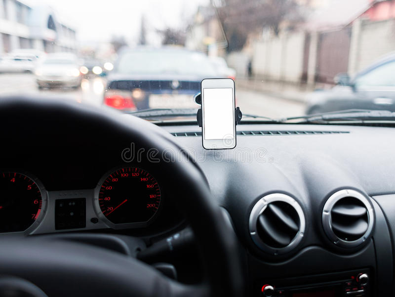 Car with Smartphone in holder. stock photo