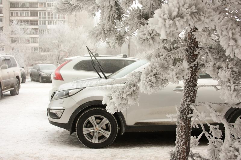 Car in the snow. snowy winter. parking car near the house. light machine and windscreen washer up from the frost. wrestling with s stock image